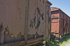 Old railway wagons in the grass Royalty Free Stock Photos