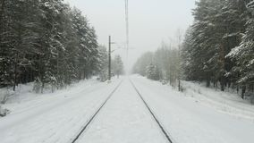 Old railway in winter forest during snowstorm.  stock video