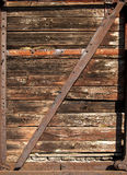 Old railway wooden wagon side. Old railway brown wooden wagon side as background stock photo