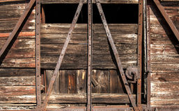 Old railway wooden wagon side. Old railway brown wooden wagon side door as background royalty free stock image