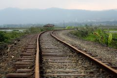 An old Railways. Ambarawa, central Java, Indonesia . Railways with mountain Background between paddy field