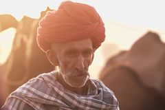 Old Rajasthani man with a red turban royalty free stock images