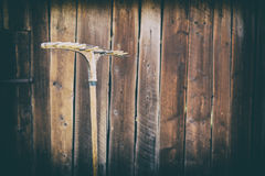 Old rake on the background of the wooden barn, retro effect, Ukraine. Old rake on the background of the wooden barn, Ukraine Stock Image