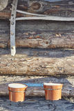 Old rake and flowerpots on wood wall Stock Images