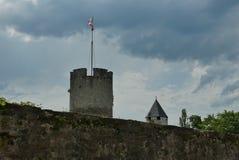 Tower and stone wall in La-Tour-de-Peiliz. Old ramparts in old town La-Tour-de-Peiliz on the lake Geneva shoreline stock photos