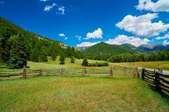 Corral in Apine Setting with Mountains stock photography
