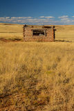 Old Ranch Homestead on the Prairie. Old homestead in Wyoming`s Hole-in-the-Wall country.  This area is famous as the outlaw hideout for the Wild Bunch including Royalty Free Stock Image