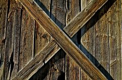 Old Ranch Stable Door. Supporting frames of a old weathered ranch door creates a perfect X Royalty Free Stock Images
