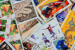 Old random used postage printed stamps from various countries and different time. For pattern, wallpaper, banner design Royalty Free Stock Images