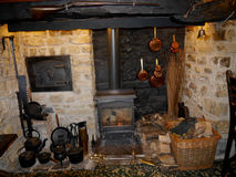 Old range and bread oven in an English pub. A typical open fireplace, with range, cooking utensils and bread oven often seen in a traditional country public Royalty Free Stock Photography