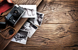Old rangefinder camera and black-and-white photos. Stock Image