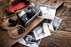 Old rangefinder camera and black-and-white photos. Royalty Free Stock Images