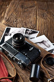 Old rangefinder camera and black-and-white photos. Royalty Free Stock Photography