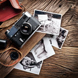 Old rangefinder camera and black-and-white photos. Stock Images