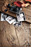 Old rangefinder camera and black-and-white photos. Royalty Free Stock Photos