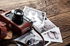 Old rangefinder camera and black-and-white photos. Stock Photography