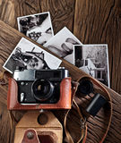 Old rangefinder camera and black-and-white photos. Royalty Free Stock Image