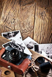 Old rangefinder camera and black-and-white photos. Royalty Free Stock Photo