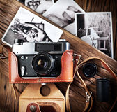 Old rangefinder camera and black-and-white photos. Stock Photos