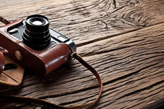 Old rangefinder camera on the old table. Royalty Free Stock Image