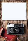 Old rangefinder camera on the old table. Royalty Free Stock Photography
