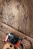 Old rangefinder camera on the old wood. Stock Image