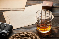 Old rangefinder camera and whiskey with antique map Royalty Free Stock Photography