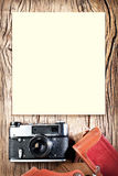 Old rangefinder camera on the wooden table. Stock Photography
