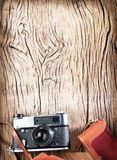 Old rangefinder camera on wooden table. Stock Photo