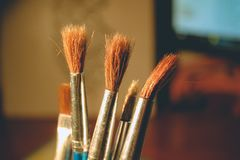 Old rare brushes. Light minimalism stock photo