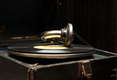 Old rarity gramophone with record. On dark background Stock Image