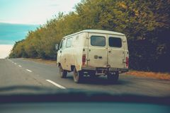 The old rarity van is on the road. View from the car Royalty Free Stock Photography