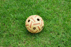 Old Rattan ball or takraw on grass Royalty Free Stock Photos