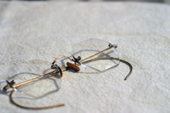 Old reading glasses. Used to read old books Royalty Free Stock Photography