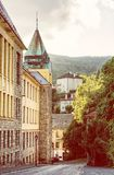 Old real school in mining town Banska Stiavnica, yellow filter Royalty Free Stock Image