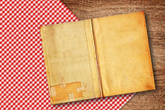 Old recipe book on kitchen table royalty free stock photos