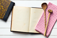 Old recipe book with kitchenware Royalty Free Stock Photo