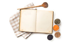 Old recipe book and lentils legumes. The old recipe book and lentils legumes Royalty Free Stock Photo