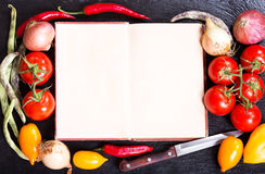 Old recipe book with vegetables for cooking Royalty Free Stock Photography