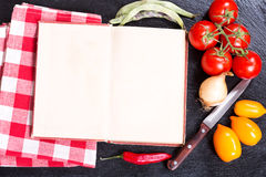 Old recipe book with vegetables for cooking Stock Photo