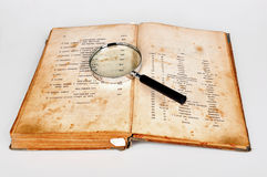Old recipes book with magnifier Stock Image