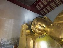 Old Reclining Buddha in the old chapel with gold color Stock Photography