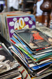 Old record album covers. Stack of old record album covers in record store Stock Photo