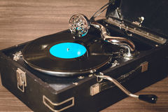 Old record player gramophone. Needle on record closeup. vintage toning Stock Photos