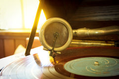 Old record player stylus on a rotating disc,music tools. Stock Photos