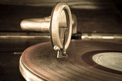 Old record player stylus on a rotating disc Royalty Free Stock Photo