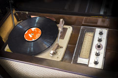 Old record player. Old vintage wooden record player with disc Stock Images