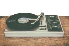 Old record player on a wooden table. Isolated on a white background royalty free stock photos