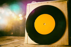 Old records on wooden table with glitter background Royalty Free Stock Photos