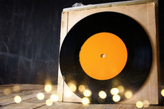 Old records on wooden table with glitter background Royalty Free Stock Photo